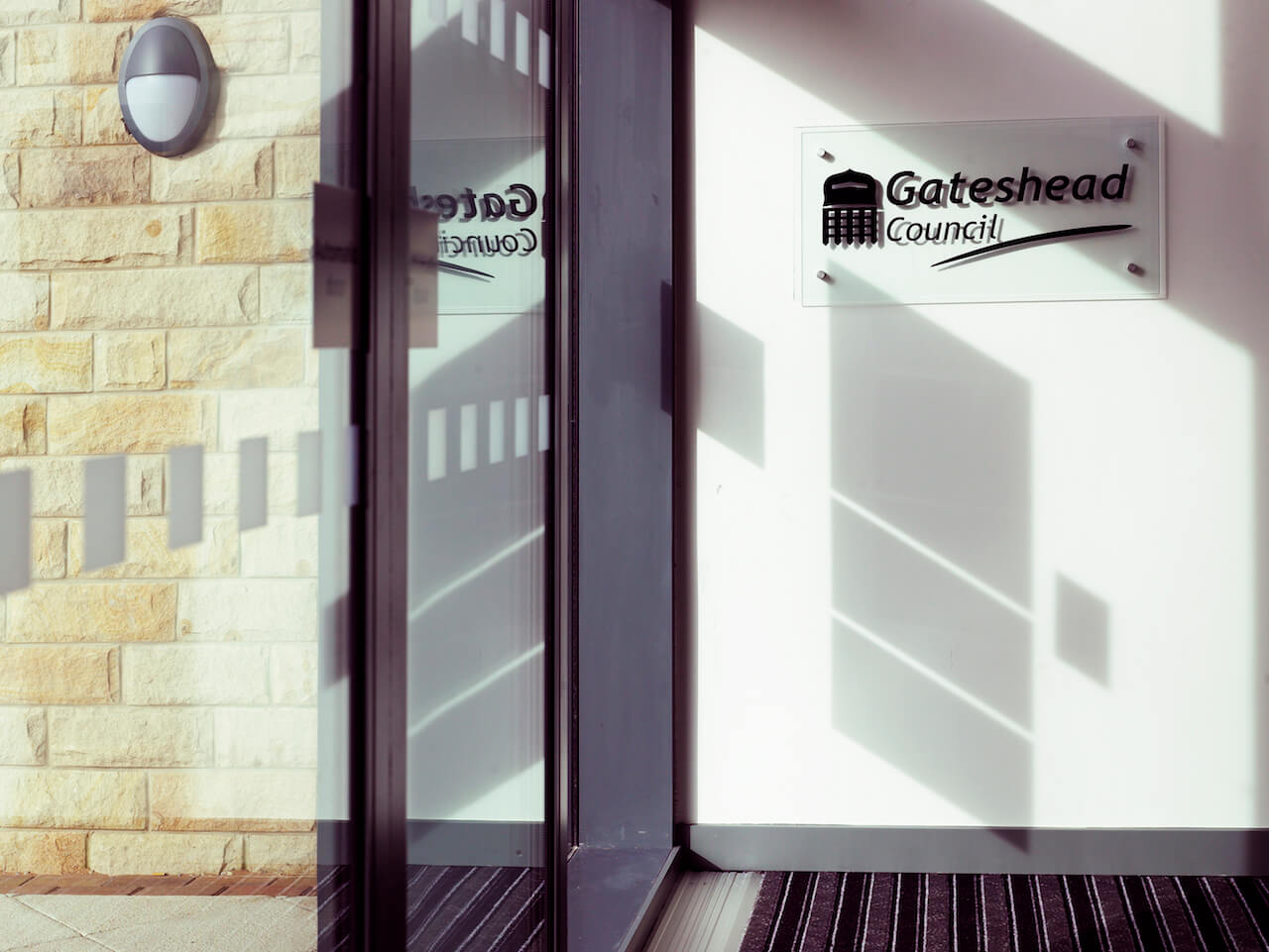 Window manifestations display Gateshead Council's logo on the sports facility doors
