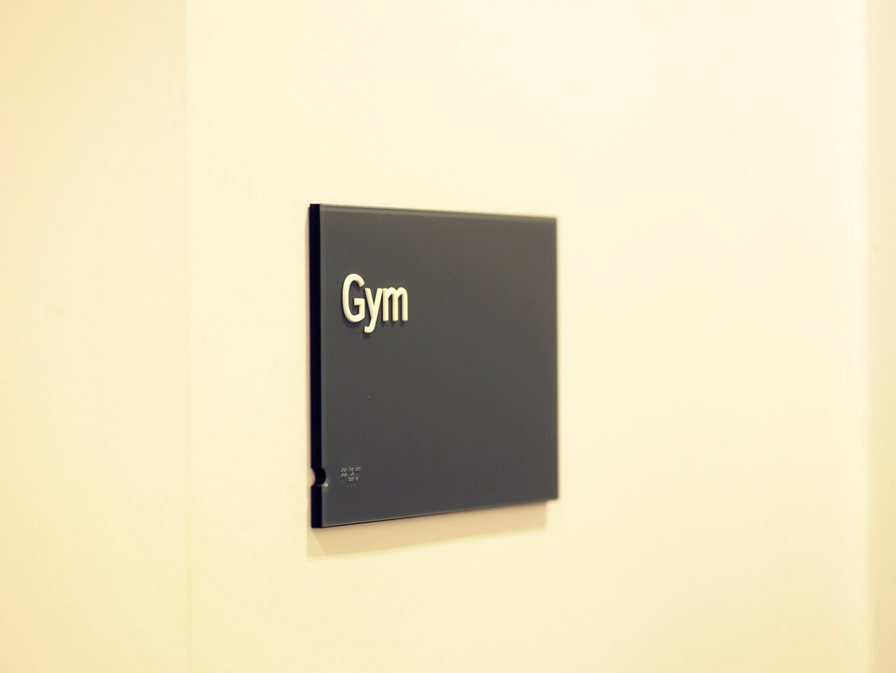 The use of Braille on this door sign is part of an accessible signage and information graphics scheme