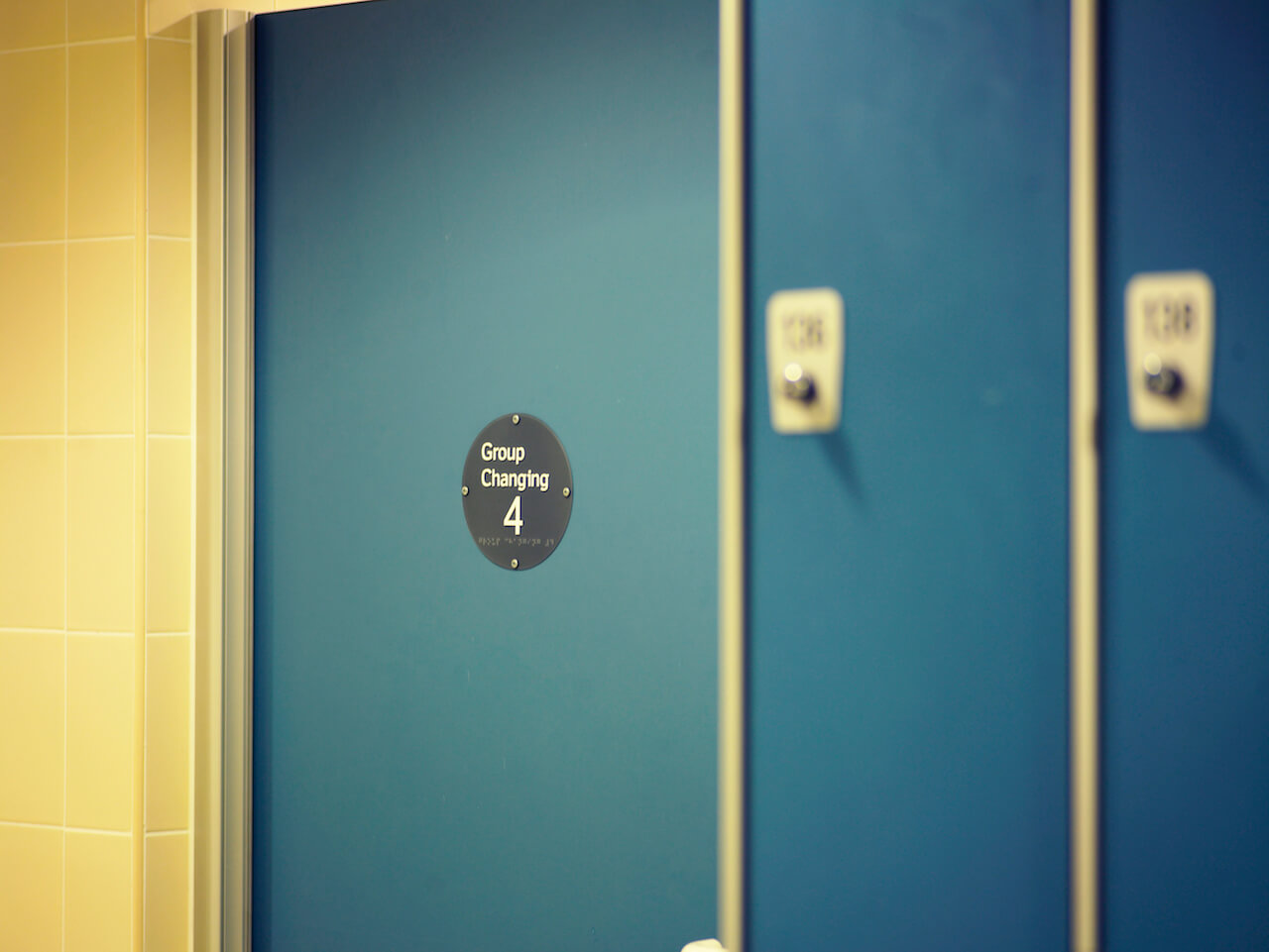 Braille is used on the door signs in this inclusive and accessible wayfinding and signage scheme