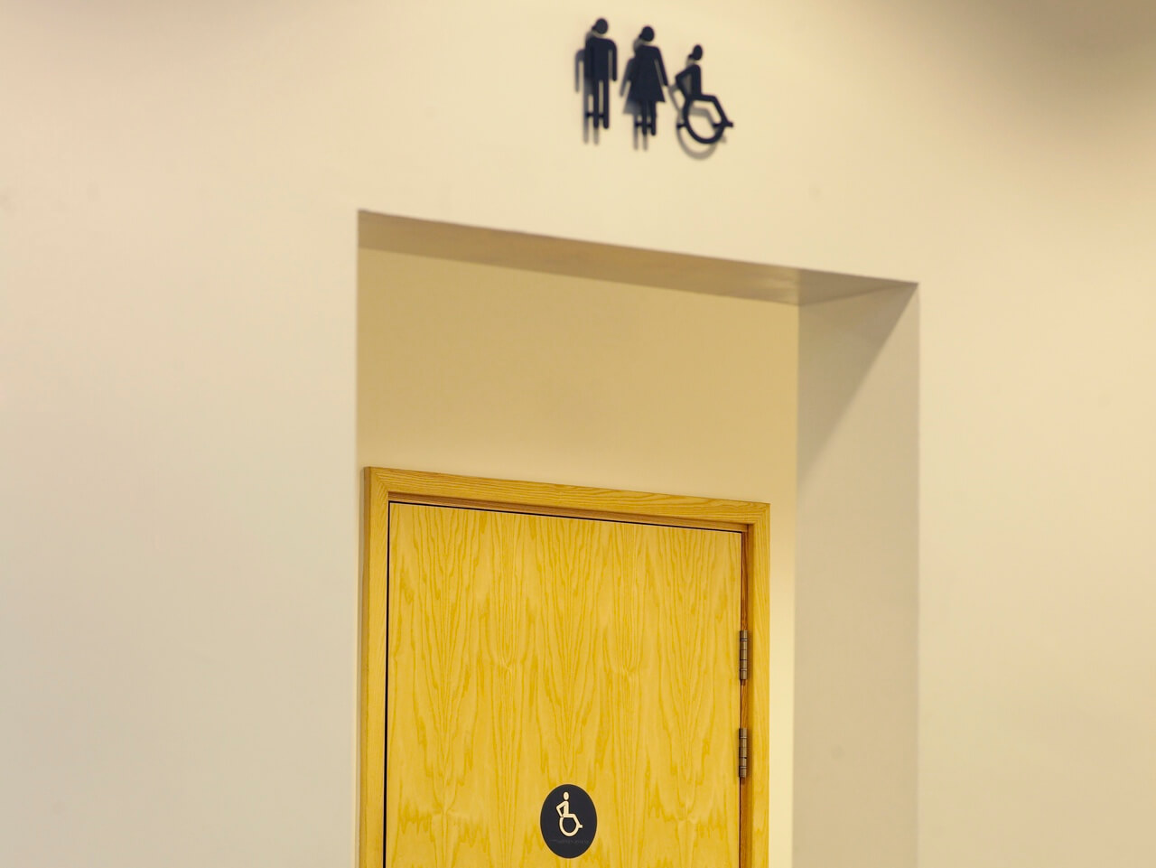 Wayfinding and signage with pictograms to indicate the location of accessible toilets