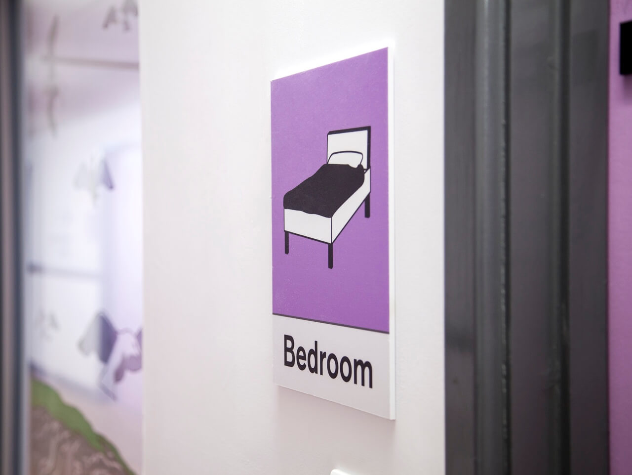 Dementia friendly signage and pictograms for bedrooms at Haven Court