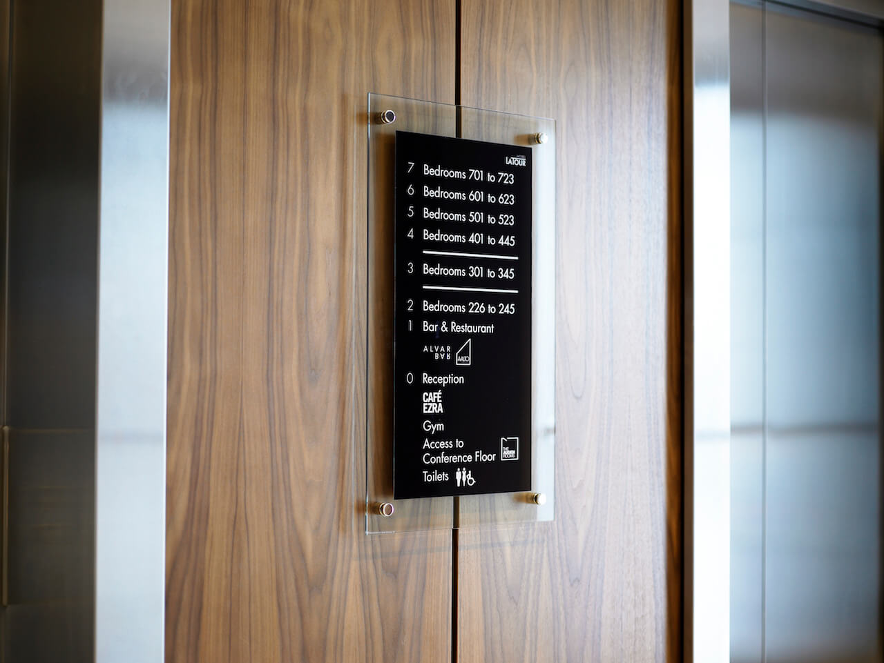 Directional signs and details as part of the wayfinding scheme at a boutique hotel