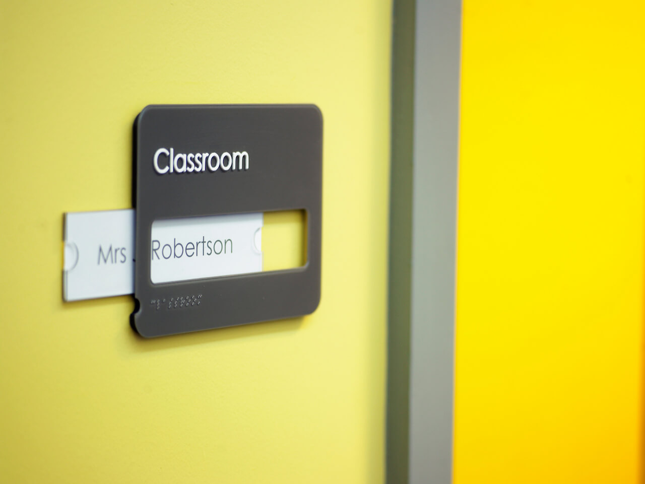 School signage with easy-to-update paper inserts