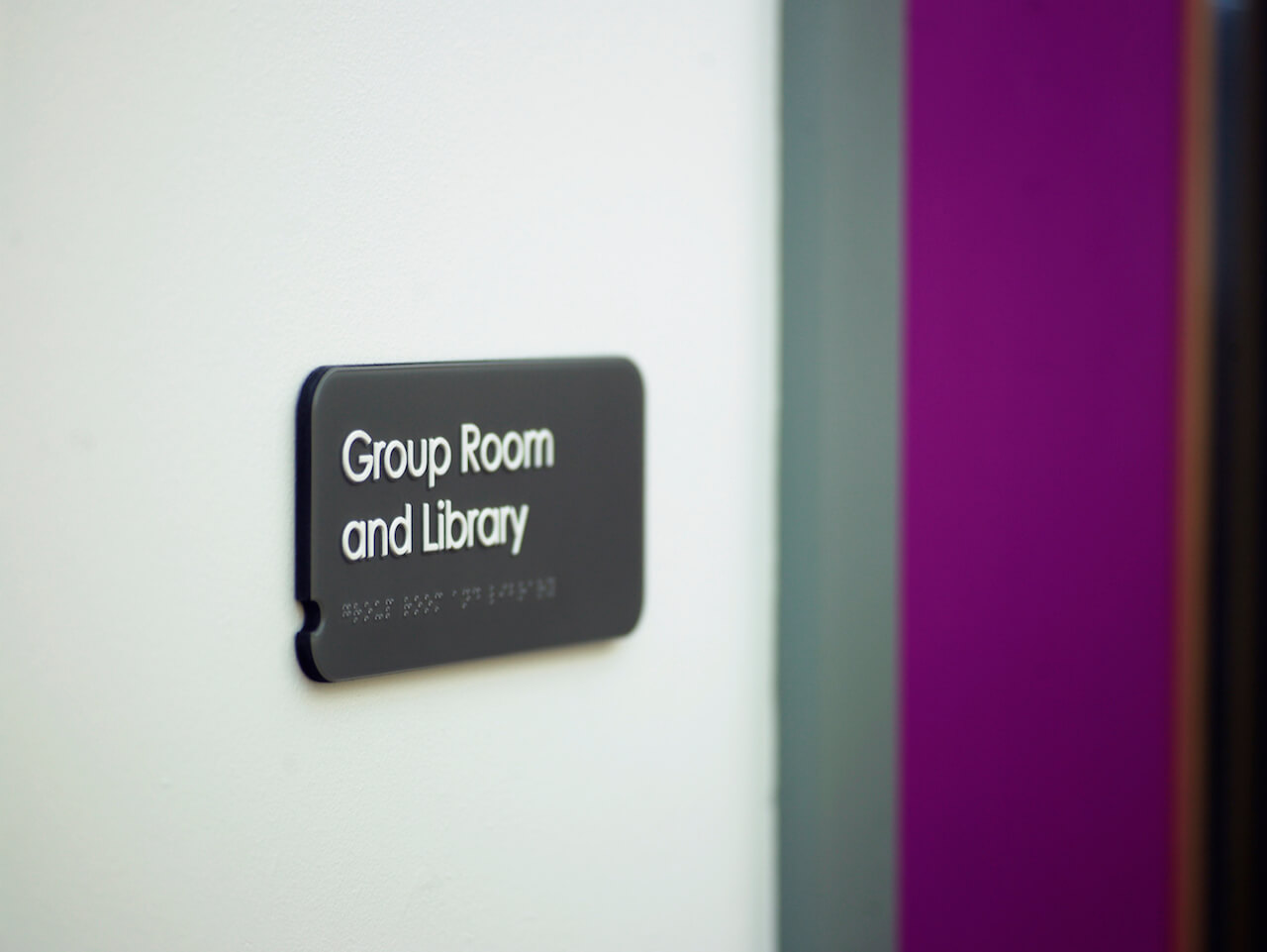 Inclusive and accessible door signage with Braille