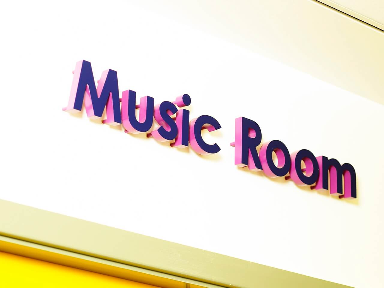 The music room at Knop Law Primary School is identified by colourful 3D signage