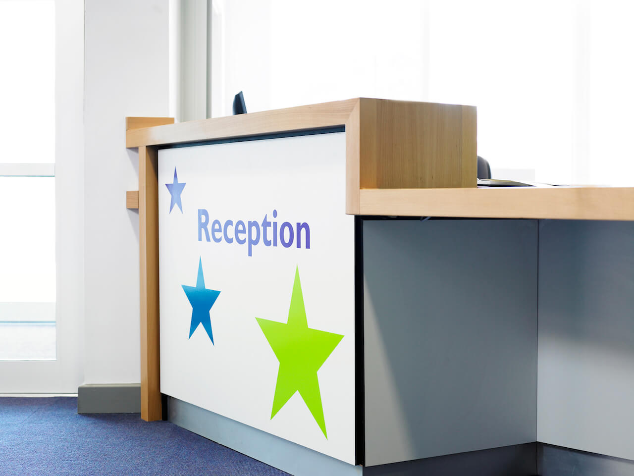 Environmental graphic design with colourful stars in the school reception area