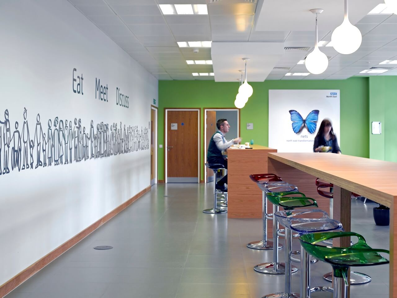 A supergraphic forms part of a workplace business signs and environmental graphics scheme for the NHS