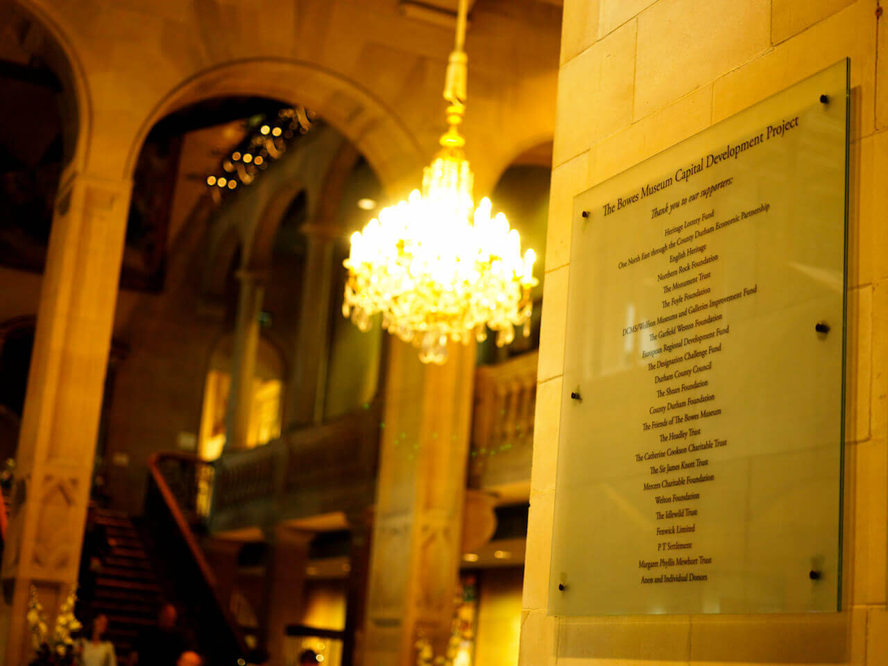 A glass sign showing the names of funders and supporters of The Bowes Museum