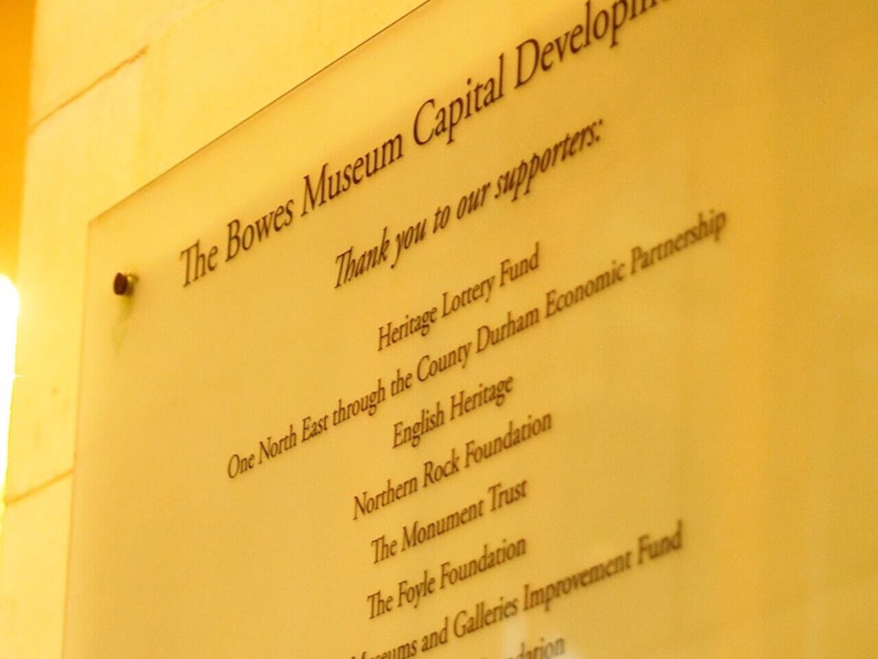 A glass sign to show the funders of The Bowes Museum