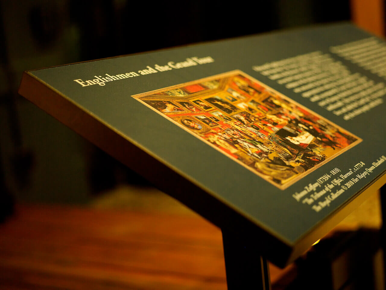 A close up image of a lecturn with exhibit images and description