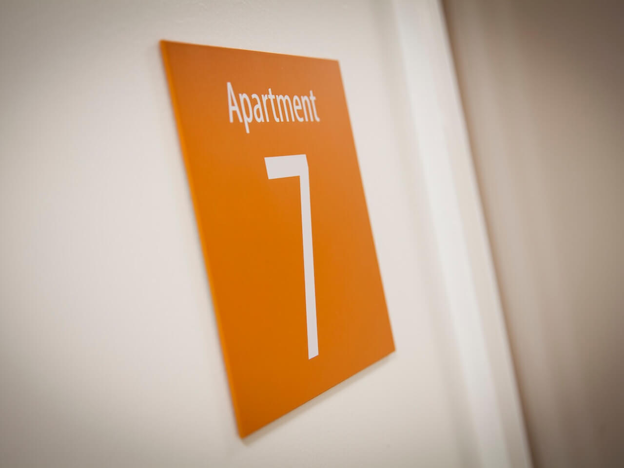 A sign showing the number of an apartment next to its entrance