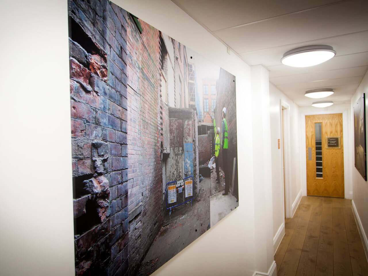 A corridor in the Bruce Building with artwork on the wall