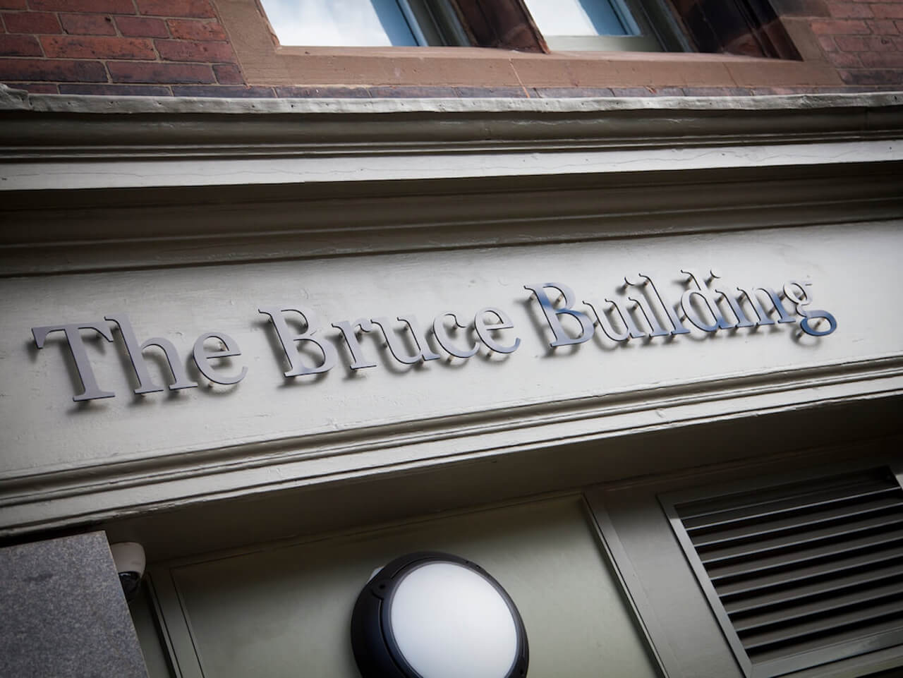 The Bruce Building external sign above the entrance