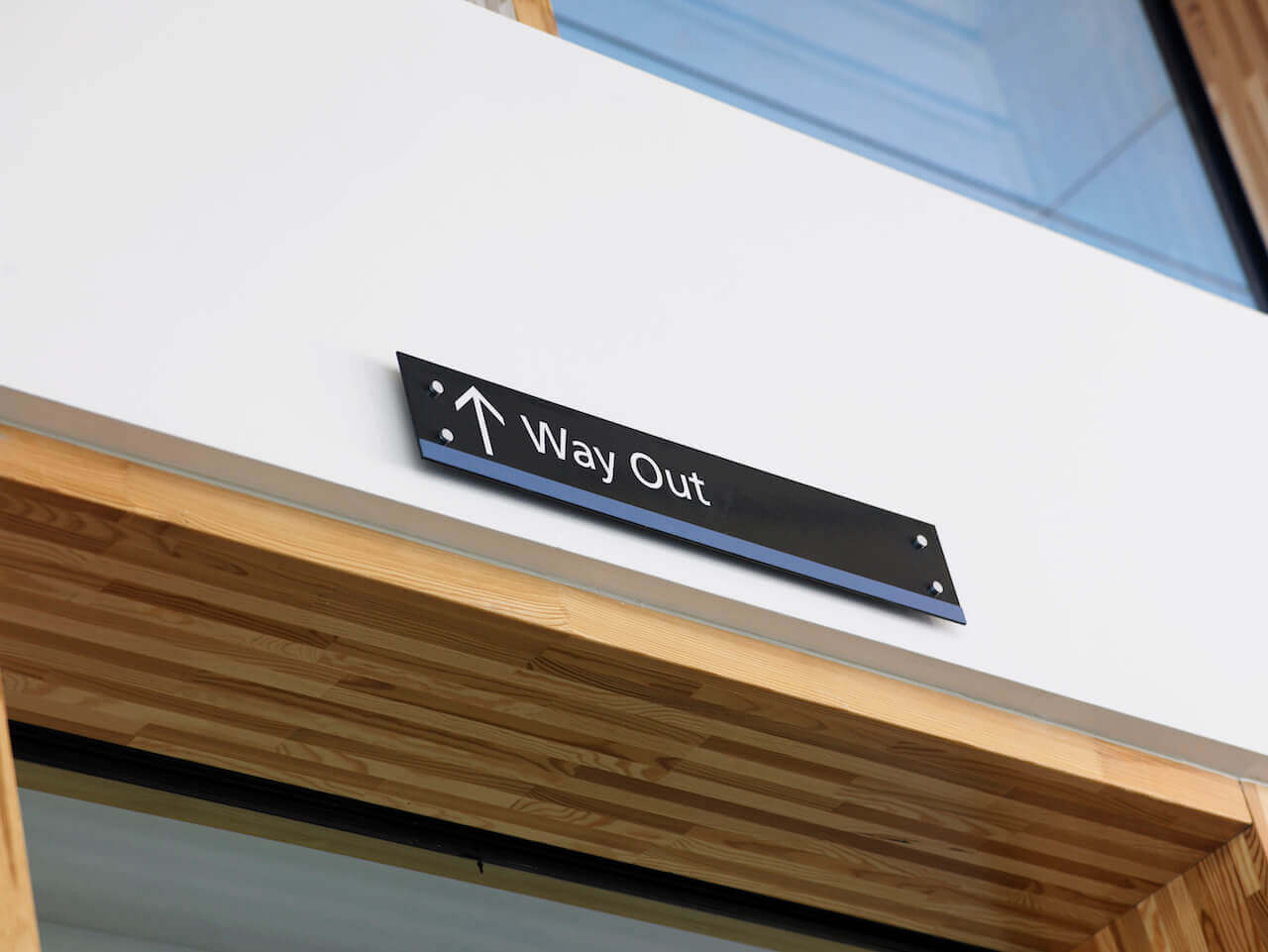 A way out sign above a doorway showing the way