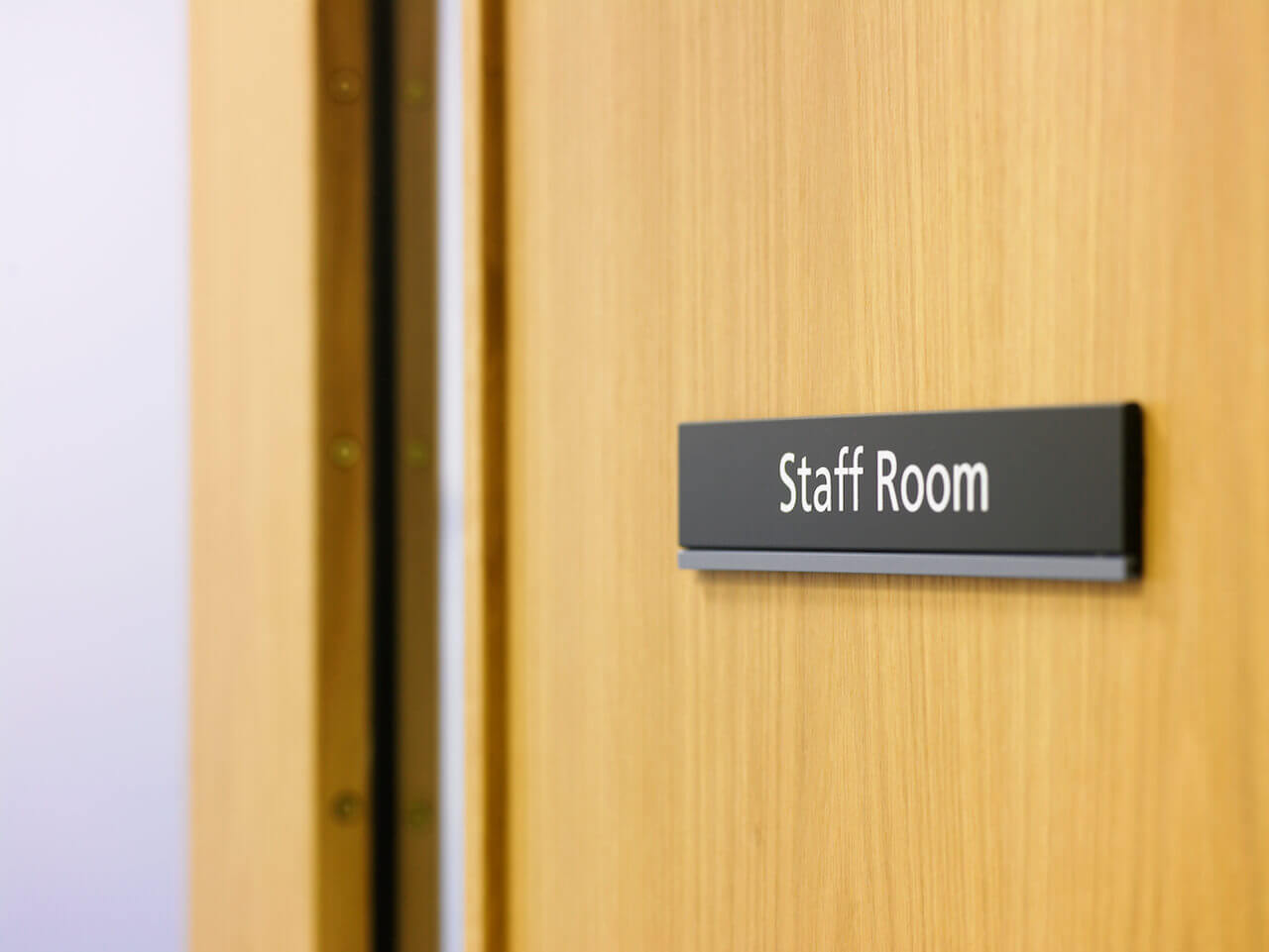 A staff room label sign on a door