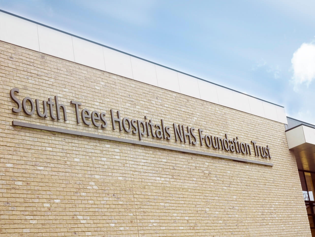 The external main sign showing the name South Tees Hospital NHS Foundation Trust