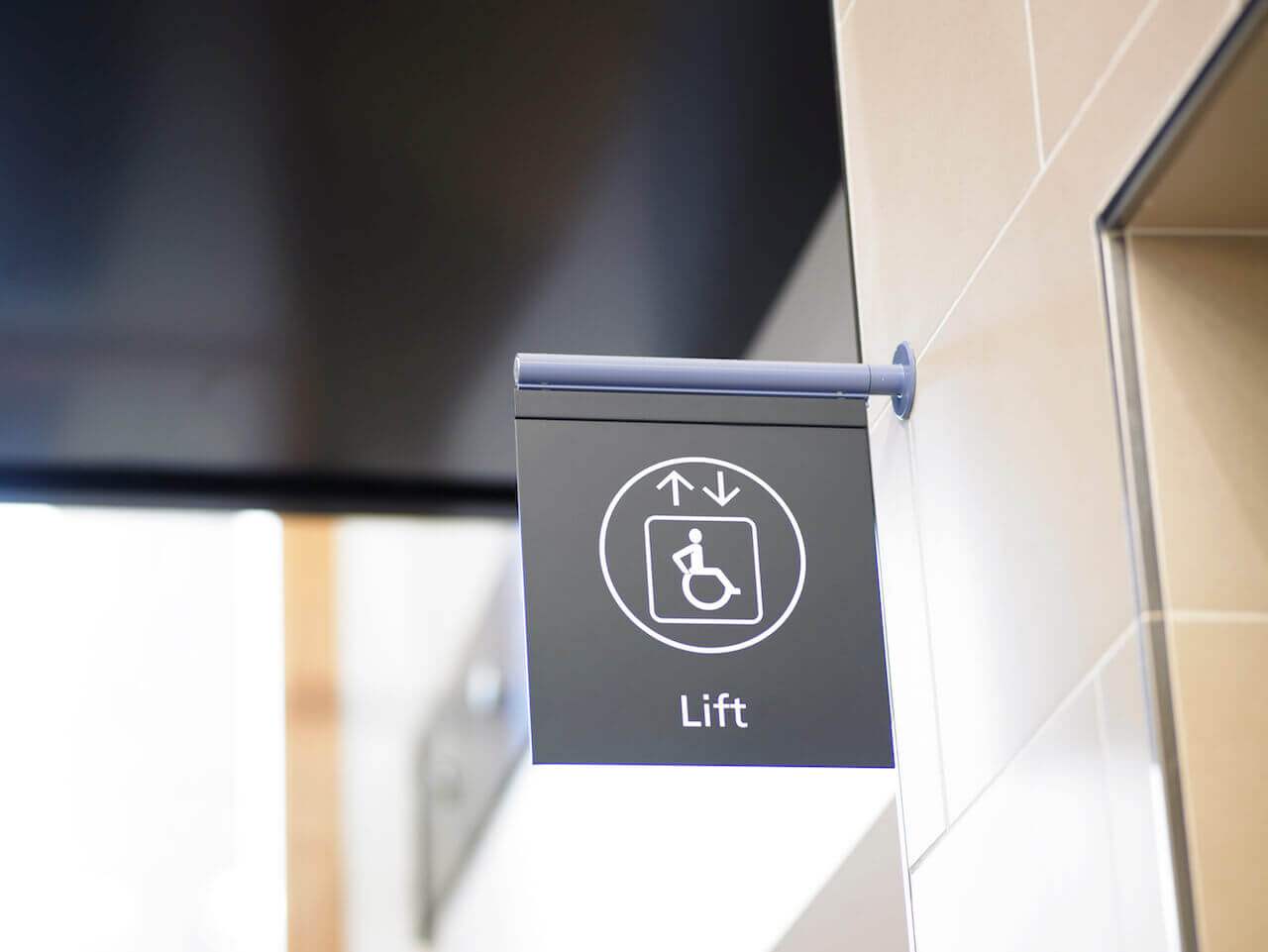 A sign for the lift showing a wheelchair icon to highlight the location