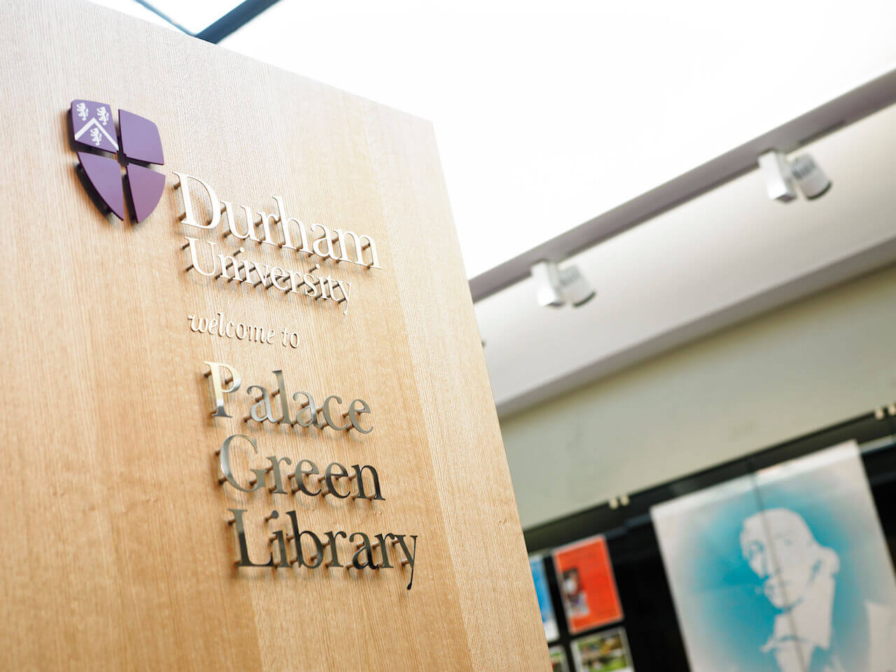 Design-led wayfinding and signage at Palace Green Library, based on Durham University's logo, corporate typefaces and colours