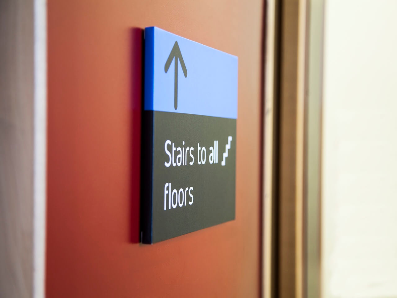 Directional stairs signage with pictogram
