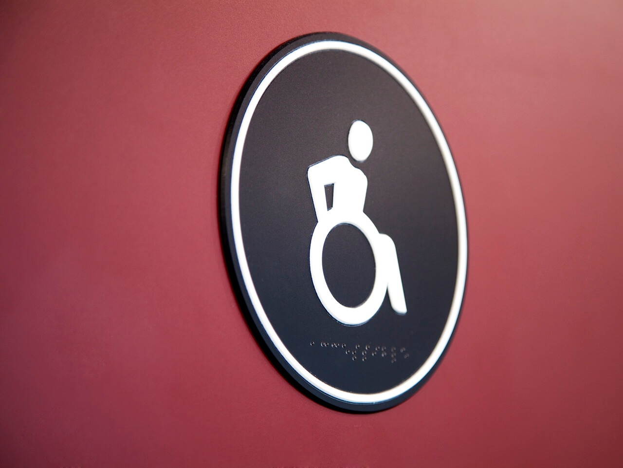 Accessible toilet signage and wayfinding pictogram with Braille