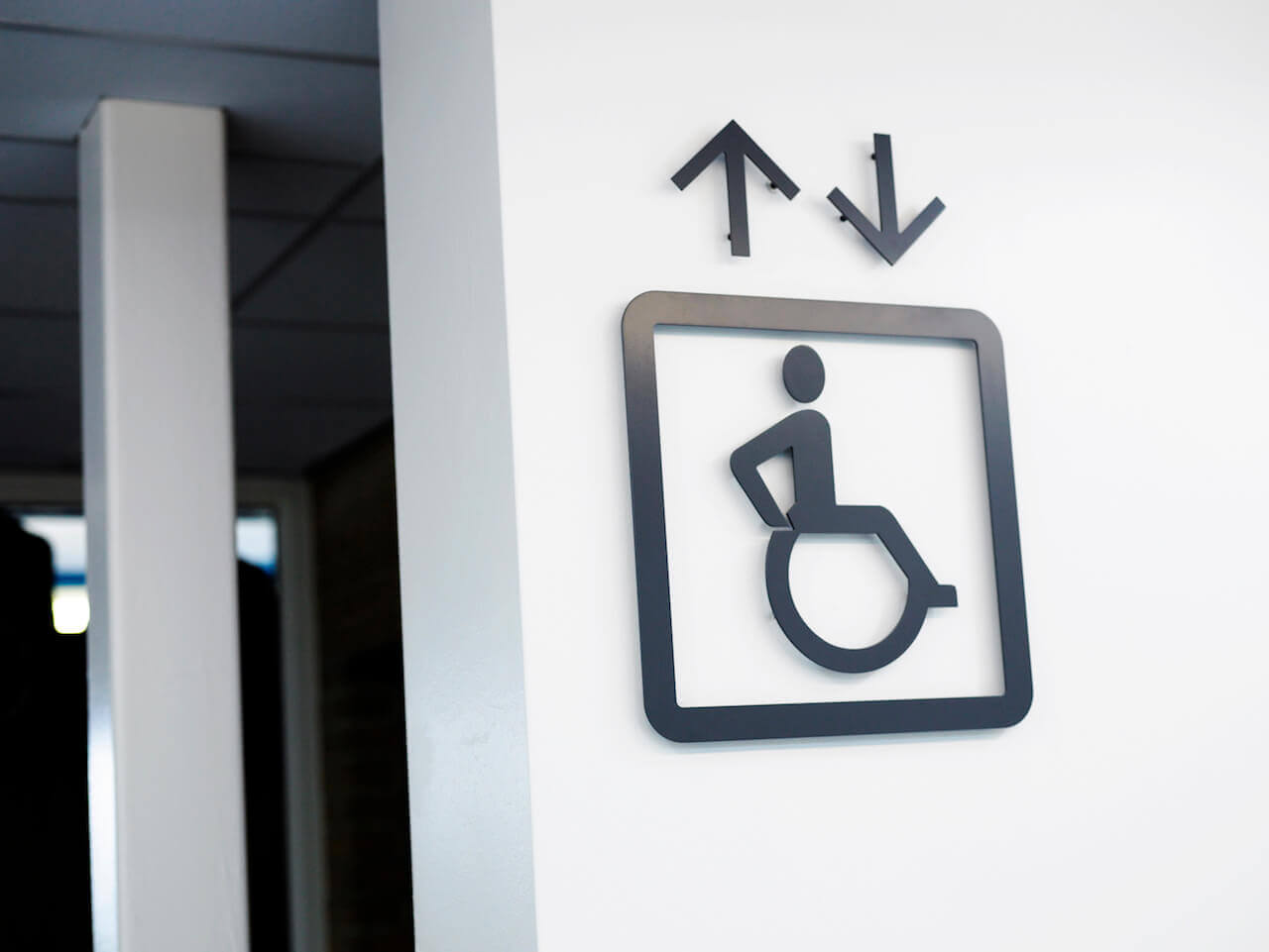 Cut out pictogram graphics indicate wheelchair accessible lifts