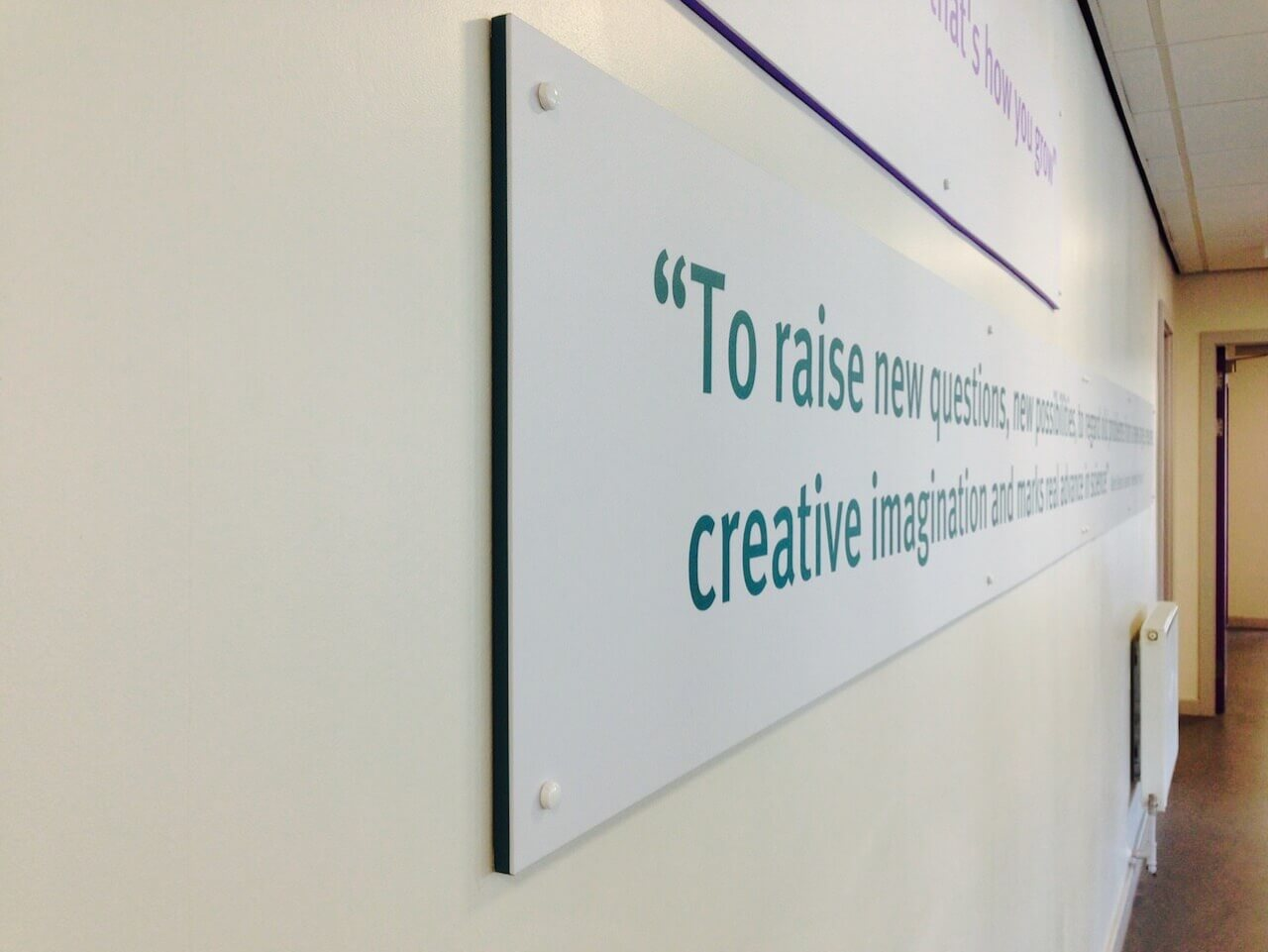 Wall mounted quotes line corridors at South Tyneside College