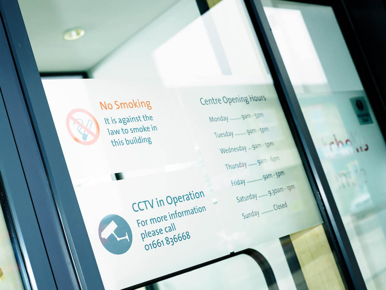 Workplace information graphics on the doors of the Spetchells Centre in Prudhoe