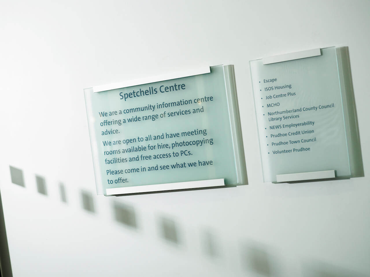 Wall mounted glass signage at the Spetchells centre
