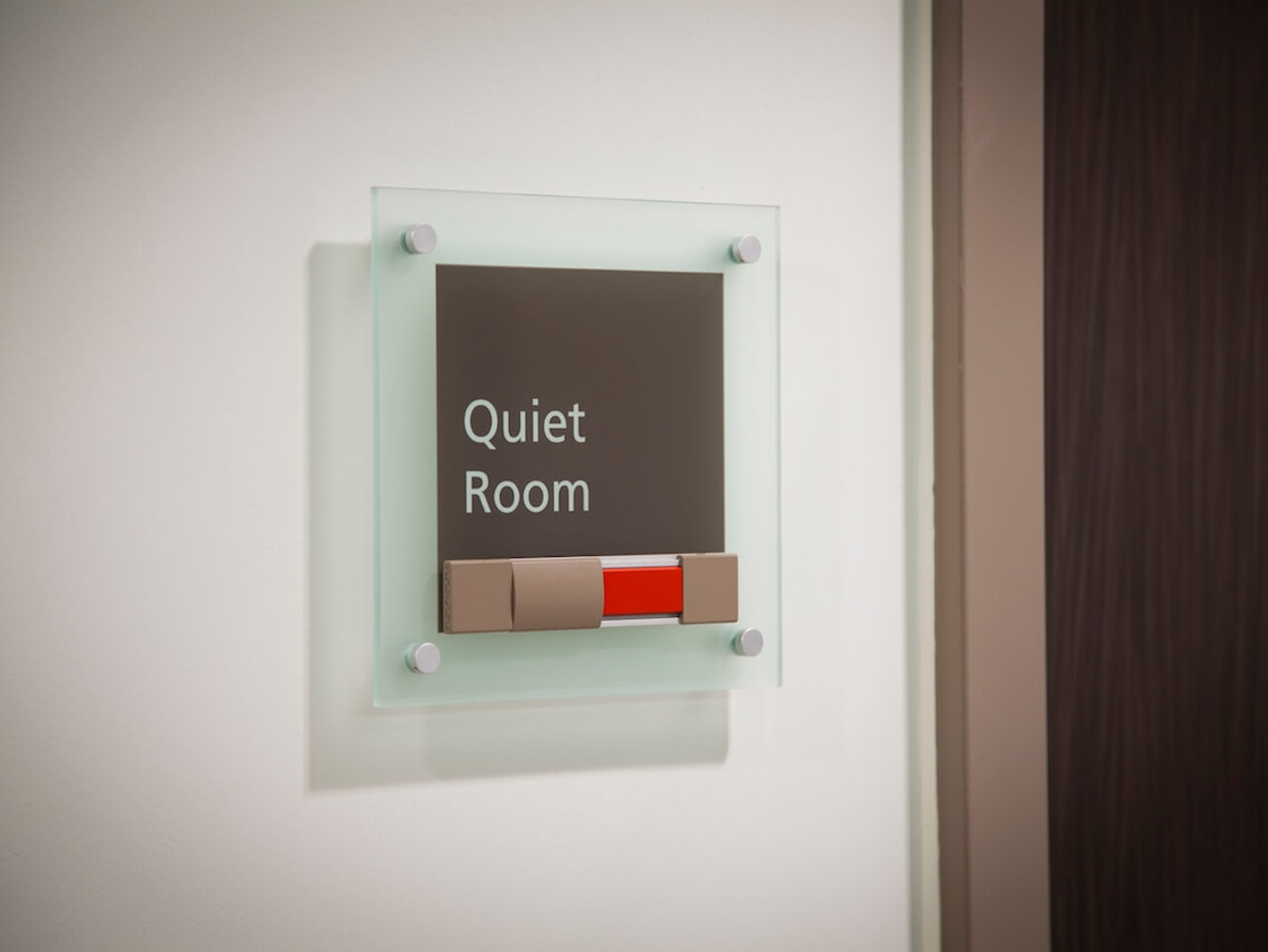 Quiet room signage with sliding detail to indicate room use