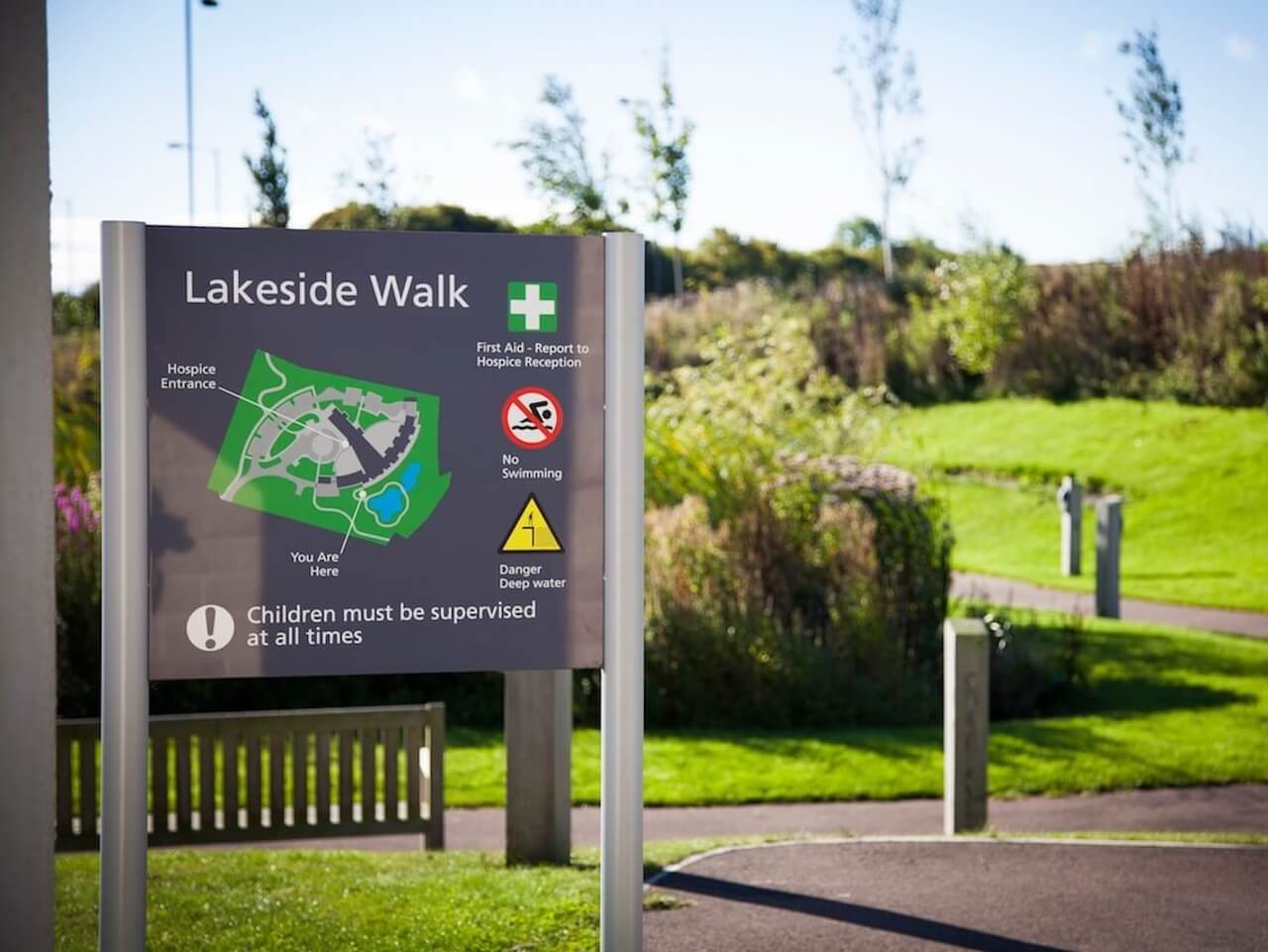 External healthcare wayfinding and signage with a map of the hospice grounds