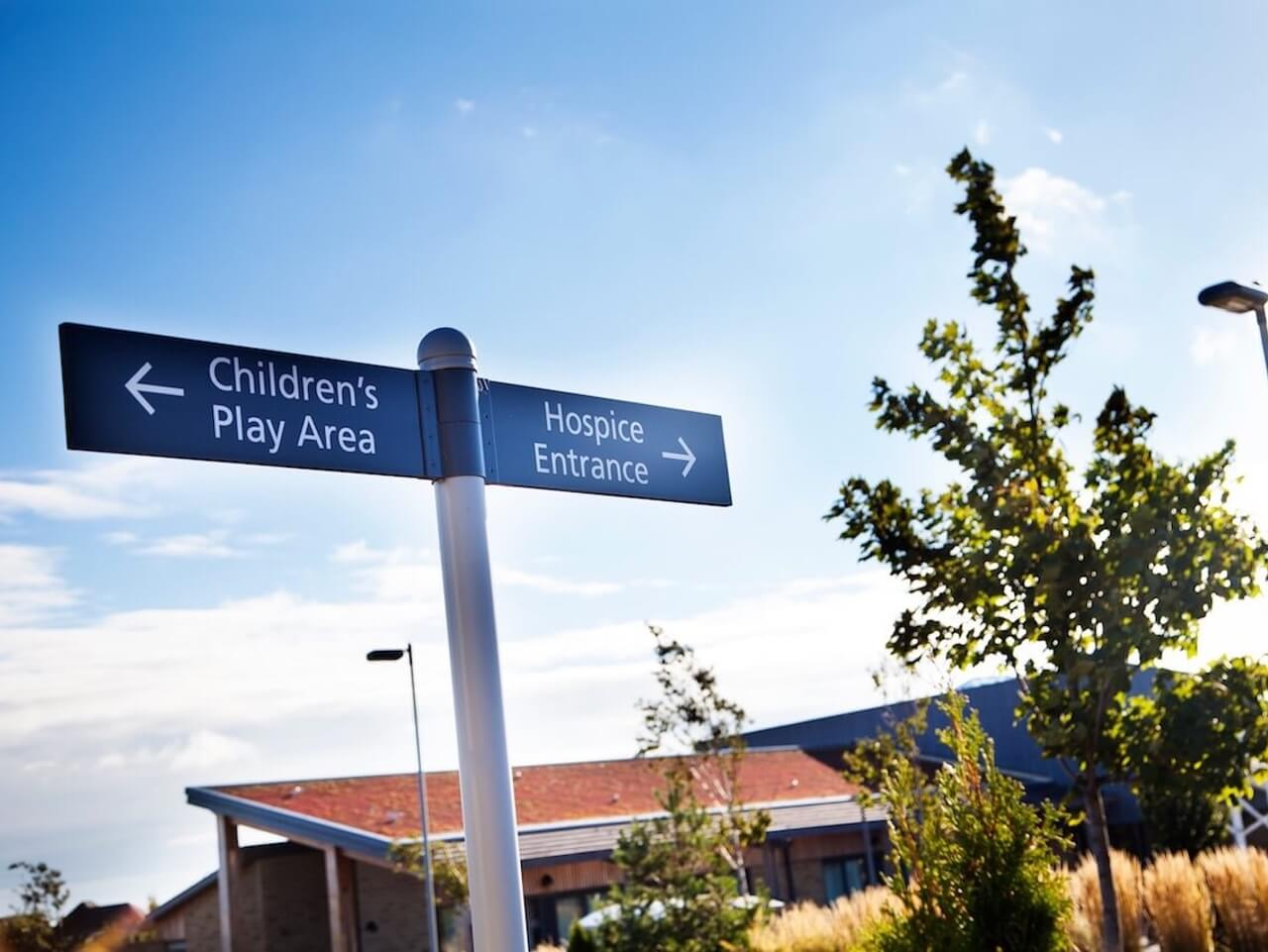 Design-led wayfinding at St Benedict's Hospice encourages people to explore the beautiful grounds and seating areas