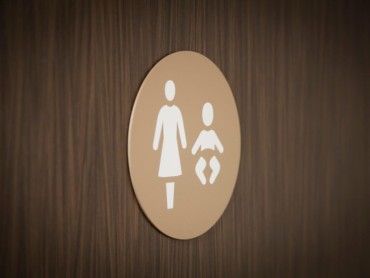 Toilet door signage with pictograms