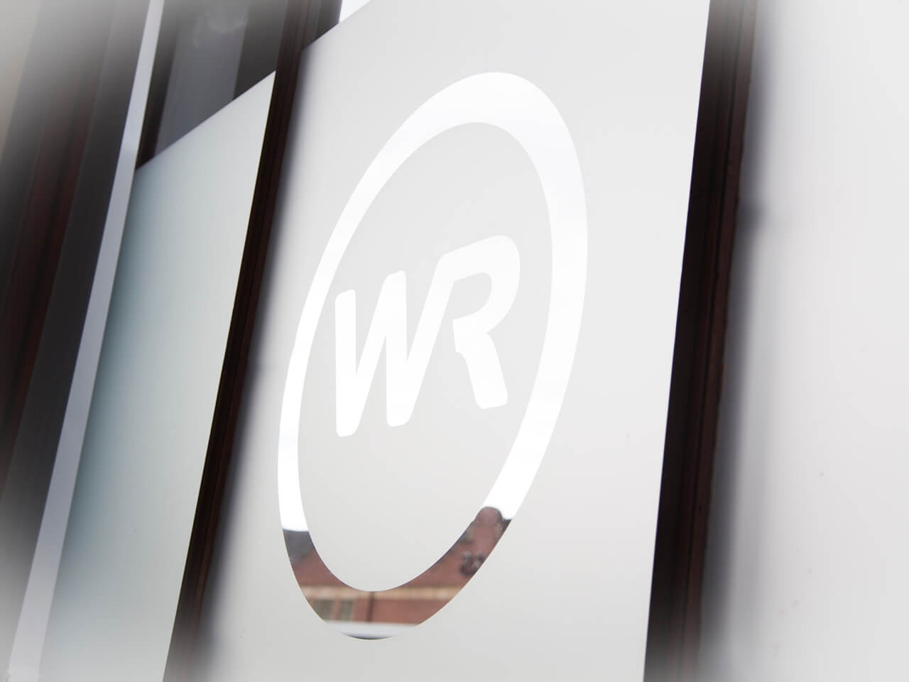 The Walton Robinson logo displayed on a window