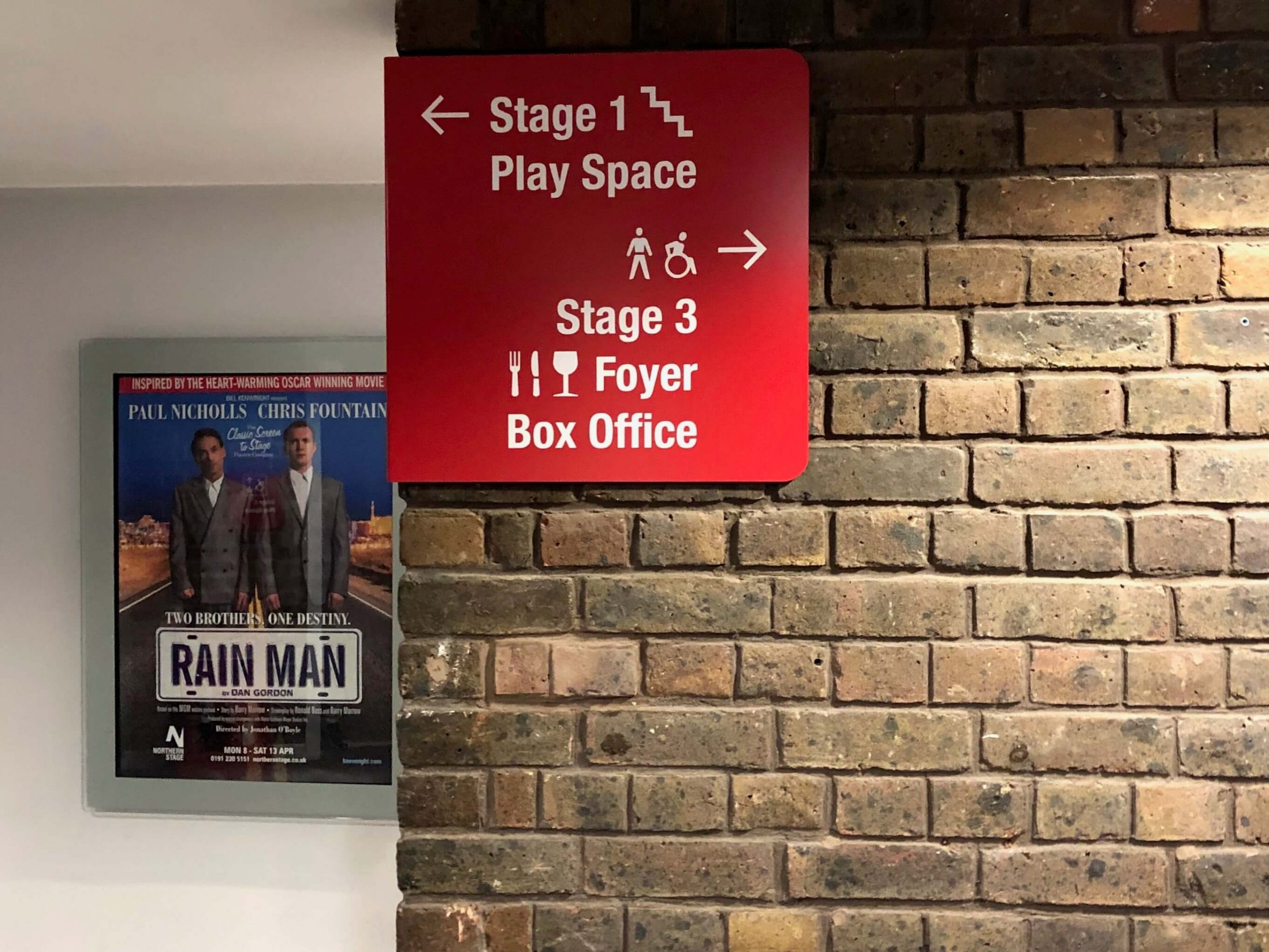 Directional signage in a theatre