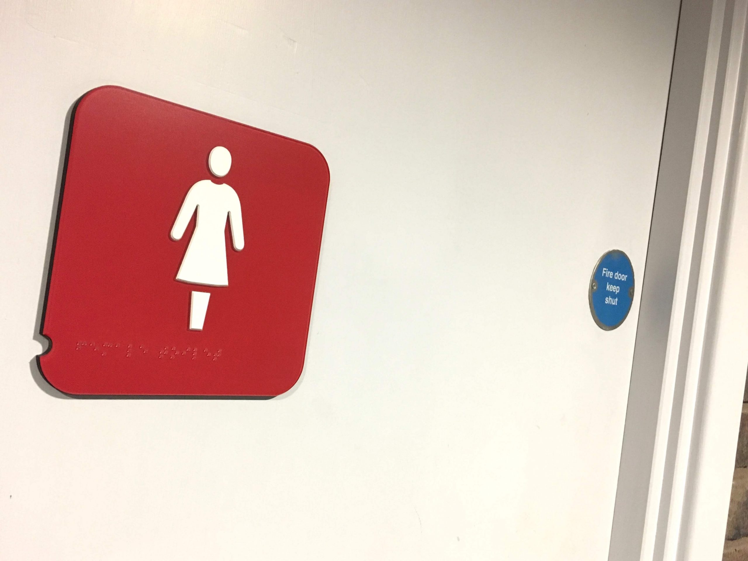 Toilet door signage with pictograms